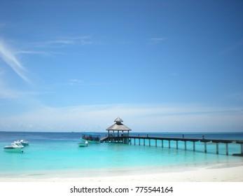 Beautiful boat dock and turquoise blue water at Baa Atoll, Maldives