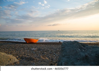 Beautiful boat on beach under blue sky and clouds/ Sochi, Olimpic village, Russia