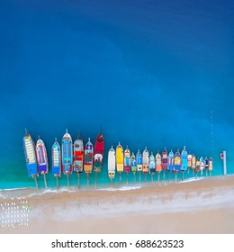 Beautiful boats. Aerial view of colorful boats in mediterranean sea in Oludeniz, Turkey. Summer seascape with ships,clear azure water and sandy beach in sunny day. Top view of yachts from flying drone