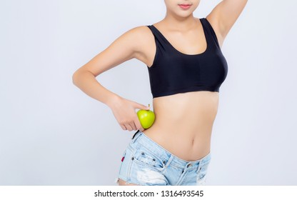 Beautiful body woman sexy slim holding green apple with cellulite for wellness, girl with fitness for weight loss and healthy isolated on white background, healthcare and diet concept.
