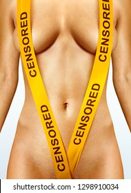 beautiful body of woman with yellow censorship tapes