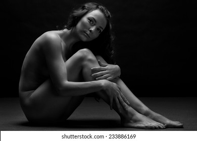 Beautiful body of young woman over dark background