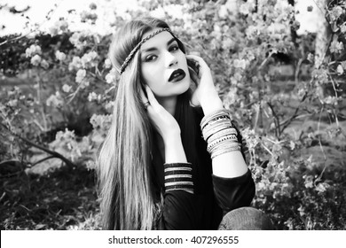 Beautiful bohemian girl in spring garden. Black and white photo of beautiful woman