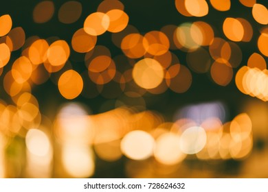 Beautiful bokeh abstract texture blurred light orange background.