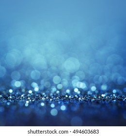 Beautiful Bokeh background with defocused lights. Blurry Abstract Festive background. Sparkling Merry Christmas card