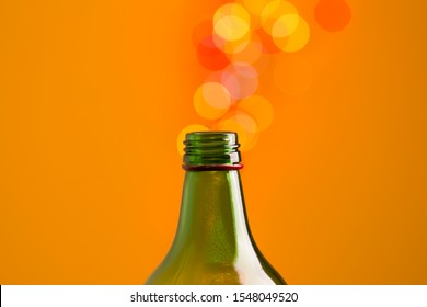 Beautiful bokeh spilling out of a glass bottleneck