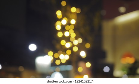 The beautiful bokeh. Vintage style. Yellow light abstract background. Bokeh for mery cristmas. Happy new year.