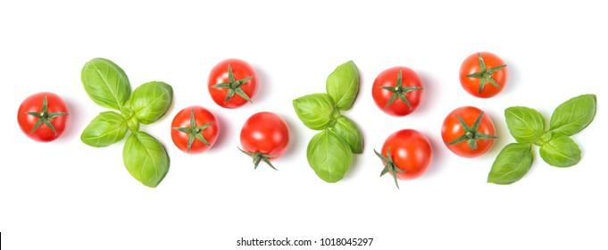 Beautiful border made of fresh cherry tomatoes with basil leaves, isolated on white background, vegetable pattern, top view