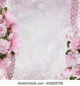 Beautiful borders of pink roses on a gentle romantic vintage background with space for text or photo