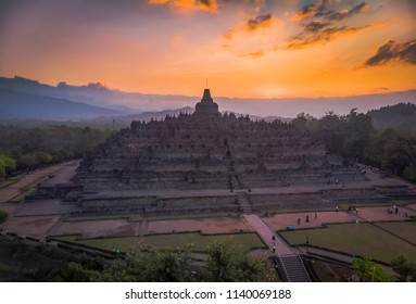 Beautiful Borobudur temple sunset in aerial photography golden hours view; July 2018