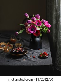 Beautiful bouquet. Breakfast with cereal granola flakes bowl, milk, nuts seeds raisins, healthy breakfast lifestyle concept, home muesli food oat meal on the black background