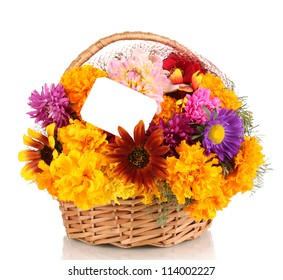 Beautiful bouquet of bright flowers in basket with paper note isolated on white