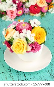 Beautiful bouquet of bright flowers in color vase,  on bright background