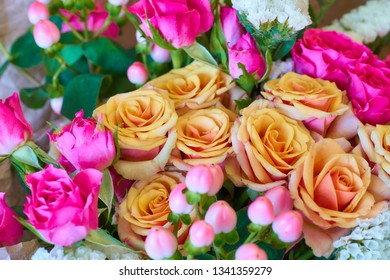 Beautiful bouquet of bright pink and beige roses.