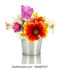beautiful bouquet of bright  wildflowers in blue metal bucket, isolated on white