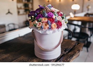 Beautiful bouquet of colorful flowers in pail on table in vintage apartment. Present, gift, paradise, event, holiday, gratulations, surprise