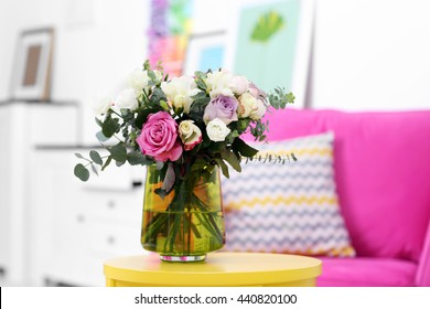 Beautiful bouquet of colourful roses in glass vase