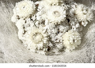 A beautiful bouquet of dried flowers in shades of white