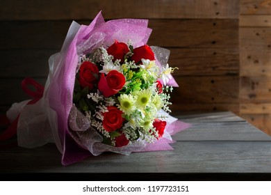 Beautiful bouquet flower made by cloth on old wooden table  background and old wooden wall dim light / Select focus, Still life, image