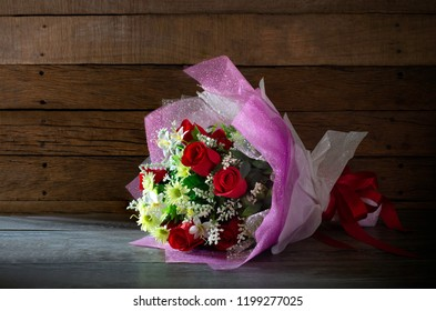 Beautiful bouquet flower made by cloth on old wooden background and old wooden wall dim light / Select focus, Still life, image