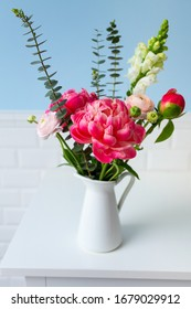 beautiful bouquet of flowers against blue wall