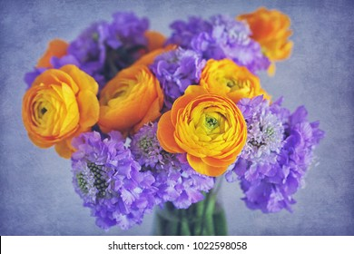 Beautiful bouquet of flowers.Yellow ranunculus flowers and scabious close-up.