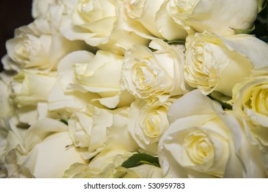Beautiful bouquet as a gift from the great white roses. A lot of flowers.