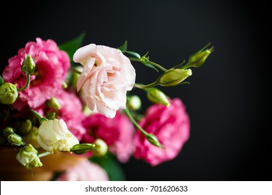 Beautiful bouquet of pink lisianthus flowers on a black background