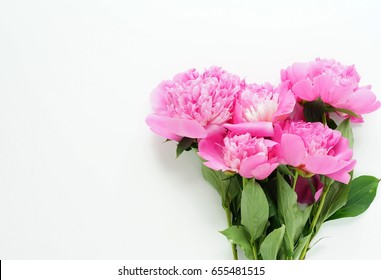 Beautiful bouquet of pink peonies on a white background. top view. copy space
