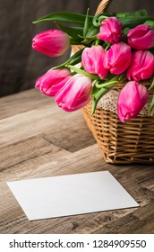 Beautiful bouquet of pink tulips and congratulations on the table