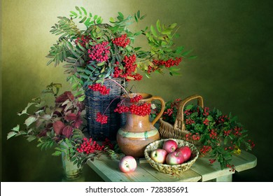 Beautiful bouquet with red berries and apples .