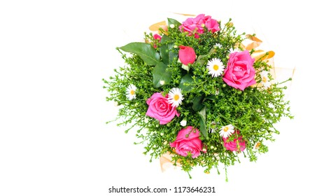 Beautiful bouquet of red and white flowers with green plants on white background. The view from the top. Flat lay. Place for your text.