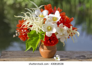 A beautiful bouquet of red and white garden flowers on nature background
