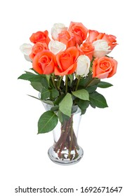 Beautiful bouquet of red and white roses in transparent glass vase. Isolated on white background