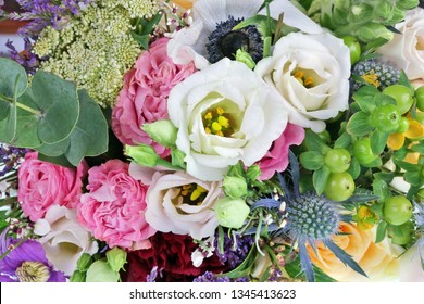 A beautiful bouquet of roses as a gift for a woman on her sixtieth anniversary. Macro studio floral background