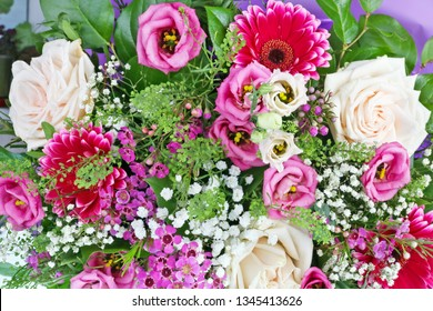 A beautiful bouquet of roses as a gift for a woman on her sixtieth anniversary. Closeup studio floral background