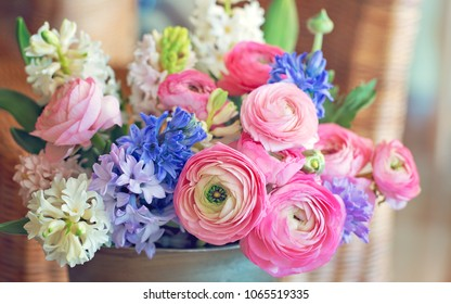 Beautiful bouquet of spring flowers in a vase on the table. Lovely bunch of flowers .