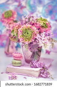 Beautiful bouquet of spring flowers in a vase on the table. Lovely bunch of flowers .Blue background.Pastel tonality.