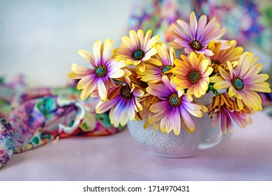 Beautiful bouquet of spring flowers in a vase on the table. Lovely bunch of flowers .Many beautiful fresh flowers on a table.