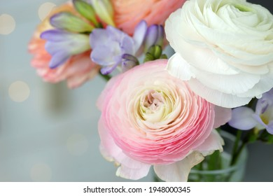 Beautiful bouquet with spring ranunculus and freesias