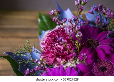 Beautiful bouquet in violet tones. Stylish bouquet of gerbera flowers with a silk bow. Close up