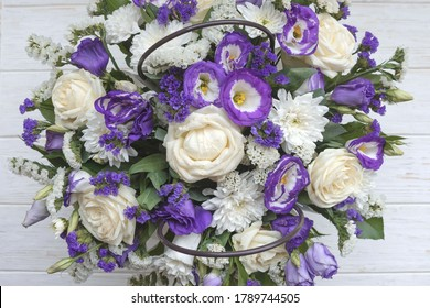 Beautiful bouquet of white and purple flowers on a white background. Flower arrangement for your beloved.