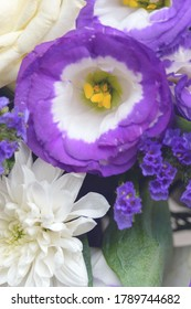 Beautiful bouquet of white and purple flowers. Decorative flower arrangement for the holiday. Closeup.