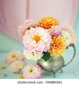 Beautiful bouquet of a yellow and pink dahlias on a light green background.Lovely bunch of flowers .
