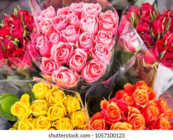 Beautiful bouquets of roses are presented in street flower shop