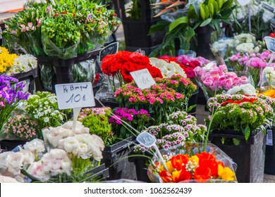 Beautiful bouquets of various flowers are presented at the street flower market