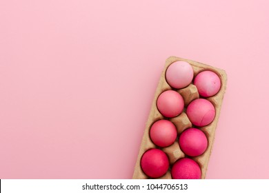 Beautiful box of dyed easter eggs in brighst colors with space for text or seasonal easter greetings