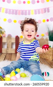 beautiful boy with Easter eggs