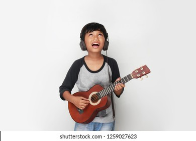 beautiful boy guitar. Cute little boy with ukulele guitar.