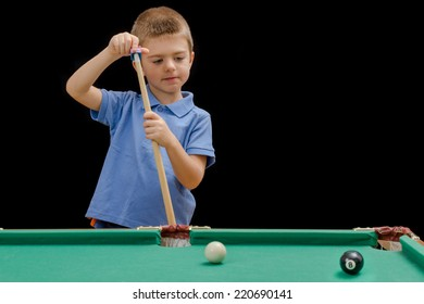 Beautiful boy playing billiard (pool)